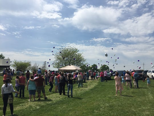 Many people remained after the memorial service for