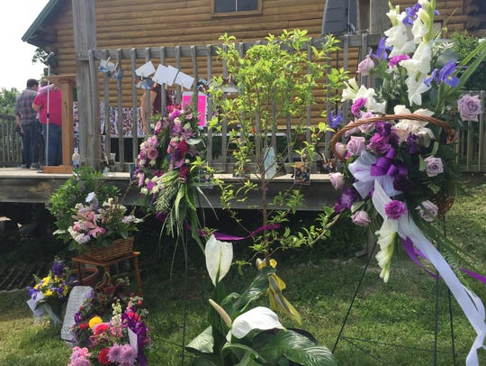 Several people brought flowers, especially purple flowers,
