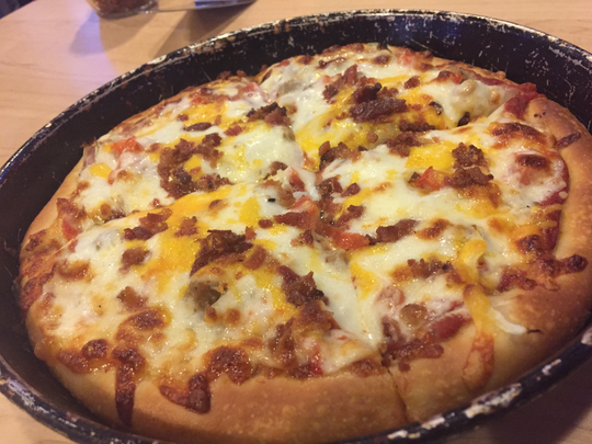The Lady Vol at Stefano's Pizza includes beef, onion, bacon, tomato and cheddar in addition to the mozzarella.