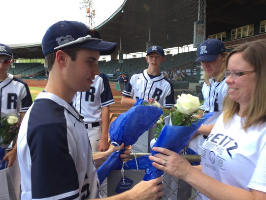 Reitz baseball player Camden Hancock gives his mom,