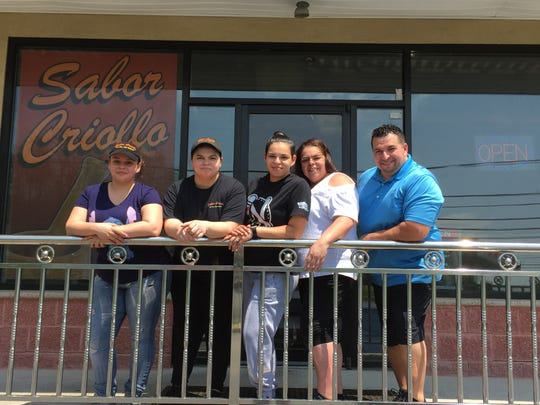 Fro mleft to right, Keyshla Quinones, Sheila Quinones, Liz Quinones, Lissette Mercado and William Quinones, owners of Sabor Criollo.