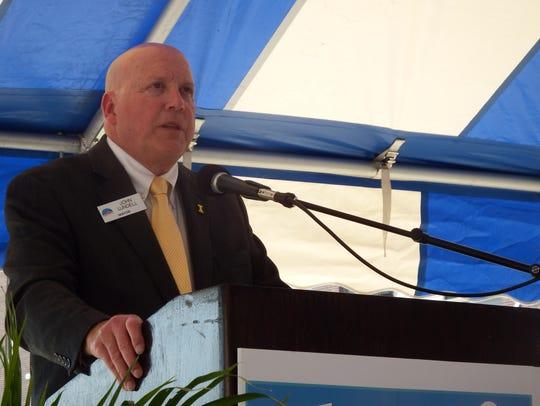 Coralville Mayor John Lundell speaks at the groundbreaking