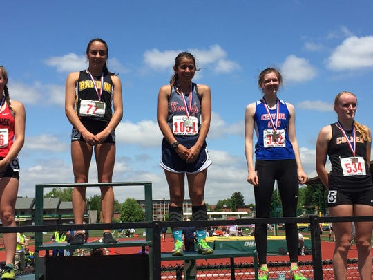 Kennedy's Alejandra Lopez receives her medal after