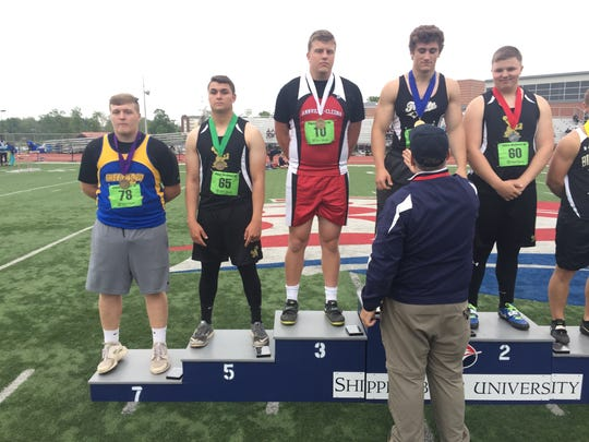 Annville-Cleona's Noah Myers, third from left, grabbed third place in AA Boys Discus with a career-best throw of 140-9.