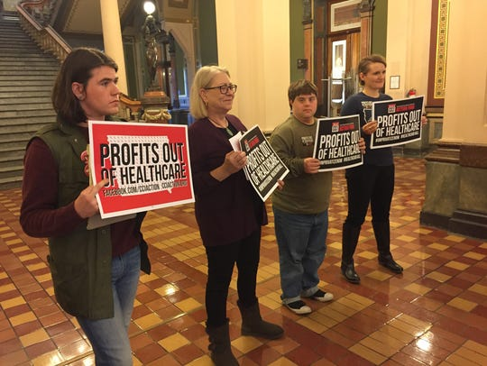 Opponents of privatized Medicaid appeared at the Iowa