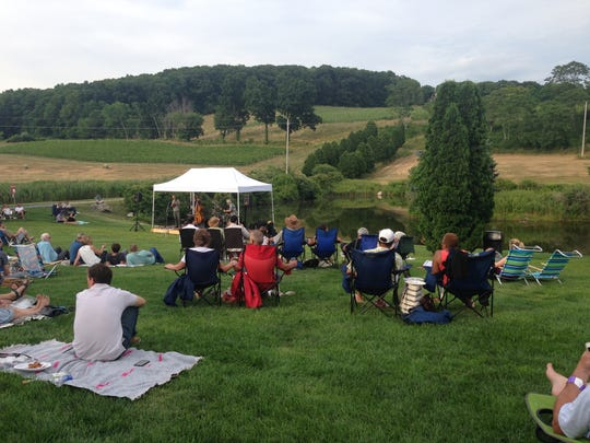 Enjoy an outdoor concert this summer, such as this one shown at Millbrook Vineyards & Winery.