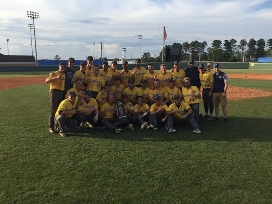 Augustana baseball takes a team photo after defeating