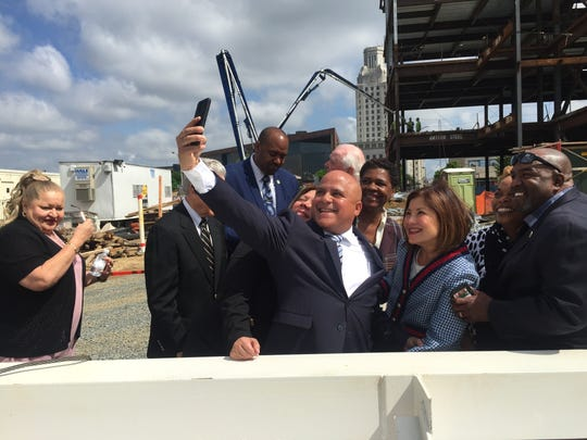 Camden Mayor Frank Moran (center) snaps a selfie at the topping-off ceremony for a Joint Health Sciences Center Thursday.