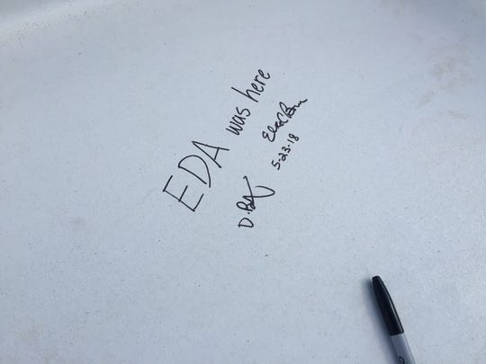 'EDA was here' is one of the message written in black Sharpie on the steel beam raised at the Joint Health Sciences Center.