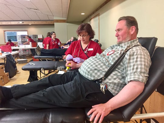 Ben Wipf of Miller Colony donates blood at the American