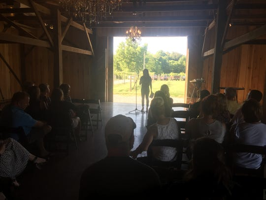 Katy Groves Mussat speaks to Farmer & Frenchman supporters Thursday evening at the winery.
