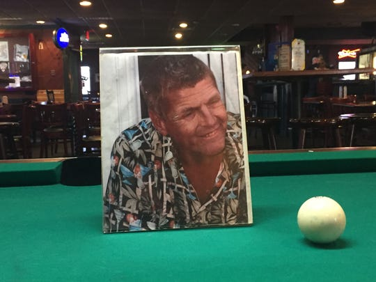 A photograph of the late Connie Macauley Jr. is displayed on a pool table at Connie Mac's Irish Pub in Pennsauken.