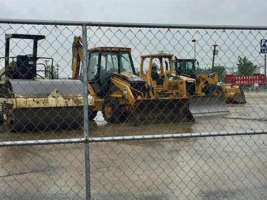 Heavy machinery sits at a demolition site that will