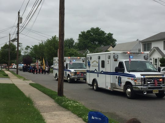 Elmwood Park Ambulance Corps make their way down the street.