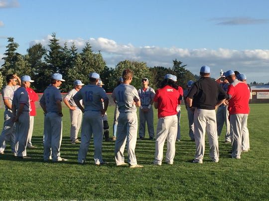 South Salem players and coaches meet after a 3-2 loss to Clackamas in the Class 6A state semifinals on May 29, 2018.