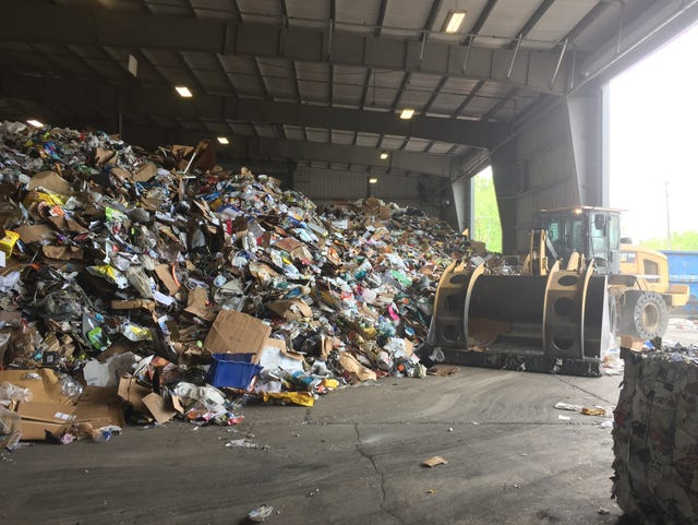 Garbage haulers pass increasing recycling costs to consumers