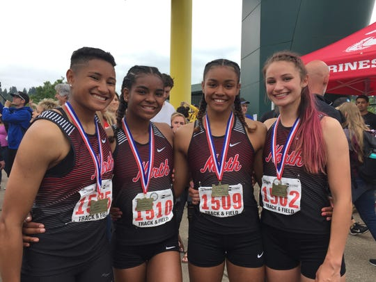 North Salem girls 4x100 relay team, from left, Rebekah