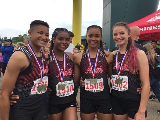 North Salem girls 4x100 relay team, from left, Rebekah