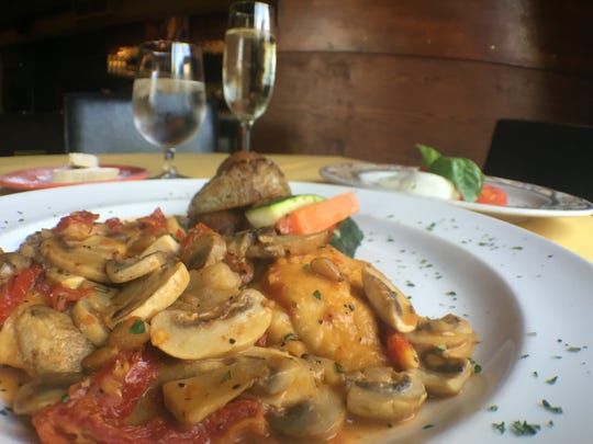 Pollo Saporito from Marcellino's, made with white-meat chicken, sauteed mushrooms, sun-dried tomatoes, pine nuts and tomato.