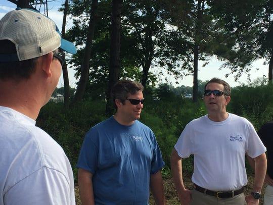 Gov. Ralph Northam, far right, chats with Chad Ballard,