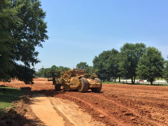 Dirt has begun to move at the BridgeWay Station development in Mauldin. Land along Interstate 385 near the Charter Communications building is pictured on Thursday, June 7, 2018.