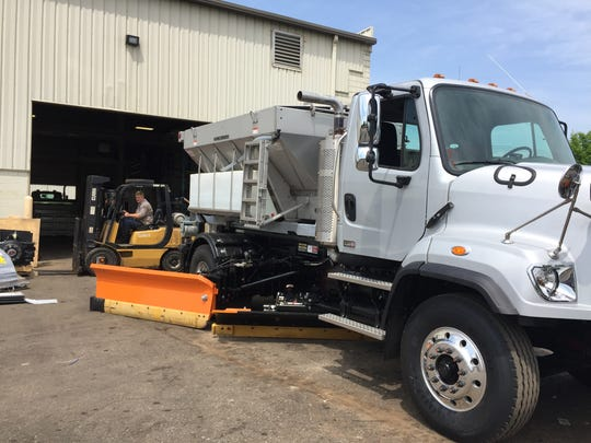 A City of Brighton swap loader truck with a wing plow