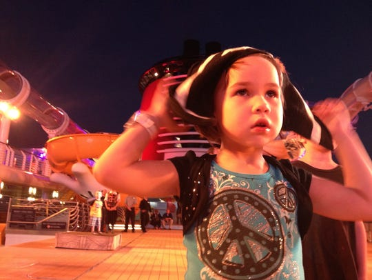 Erysse Elliott watches fireworks aboard the Disney