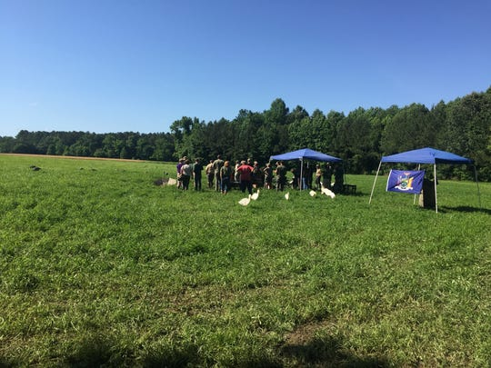 Participants gather at the start of the North American Hunting Retriever Association Invitational on Thursday, June 7, 2018 near Cashville, Virginia.
