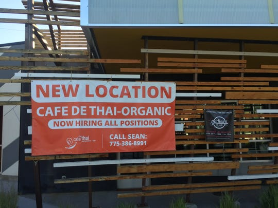 A sign announces Cafe de Thai-Organic's new location in the Sticks development in Midtown Reno.