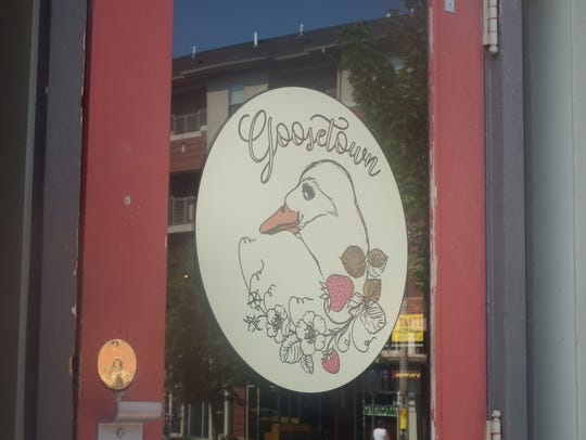 A decal on the door for Goosetown Cafe in Iowa City's