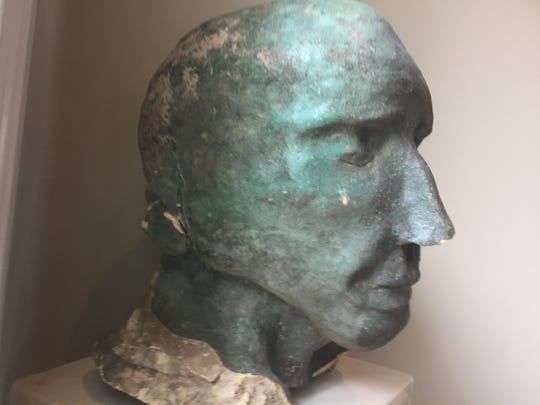 The statue head found in the Red River slightly larger
