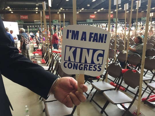 Iowa Republican convention delegates used fans promoting