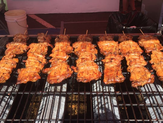 Chicken on the grill at the Koko's booth at the Reno