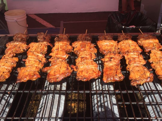 Chicken on the grill at the Koko's booth at the Reno Rodeo food court.