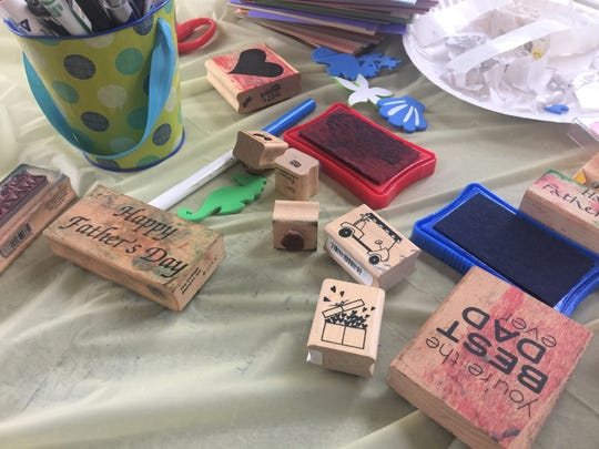 Kids made crafts using stamps, stickers and more on
