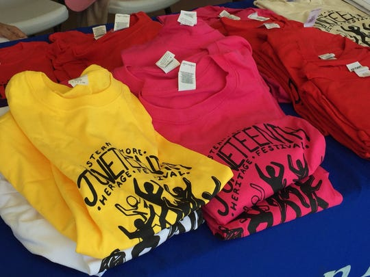 Shirts sit on a table Saturday during the 19th annual Juneteenth celebration in Exmore, Virginia.