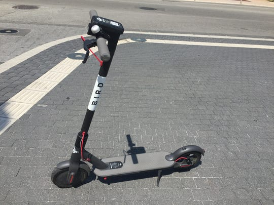 The Bird scooter is parked and ready to go.