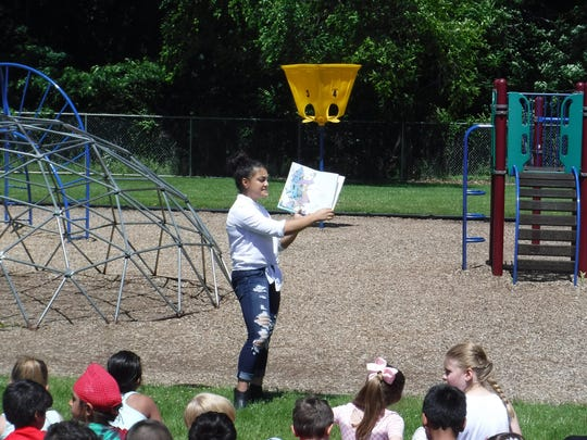 "Olympic gold medalist Laurie Hernandez read, ""Oh, the Places You'll Go!"" By Dr. Suess at a recent unveiling for the area's newest Little Free Library, now installed in front of the Barclay Brook School."