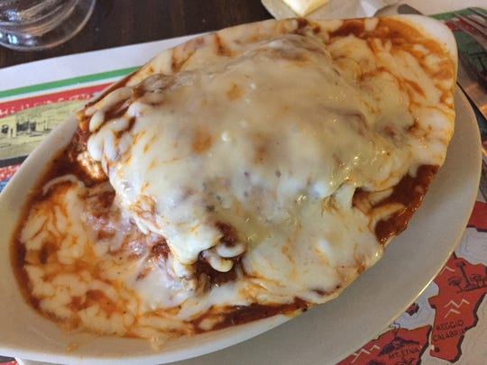 A cheesy portion of lasagna ($9) at Tumea & Sons in Des Moines.