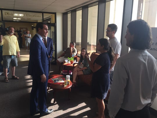 Chris King stops to talk to people outside the Division