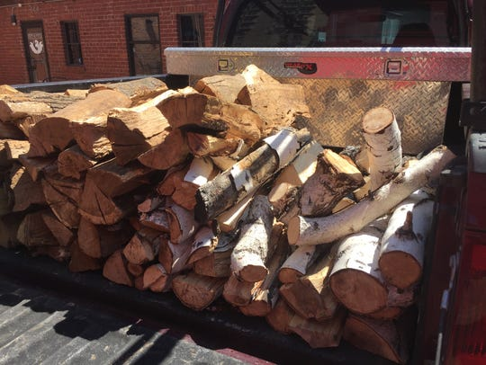 Loads of local hardwood fuel the fire in the Italian-made
