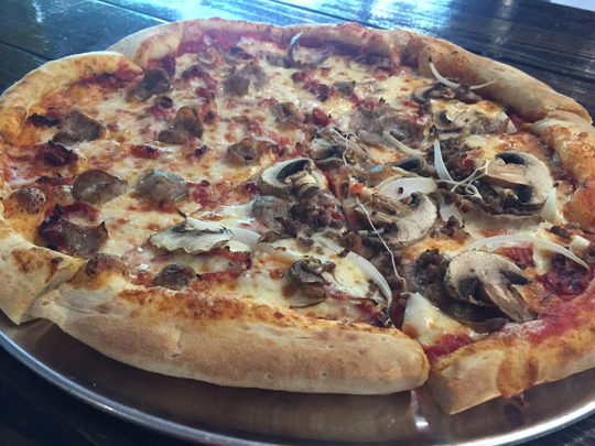 This pie from South Coast Pizza has Italian sausage and sun-dried tomatoes on one half and beef, onions and mushrooms on the other.