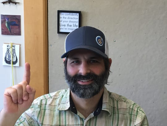 Brando Rich holds up one finger - the traditional sign