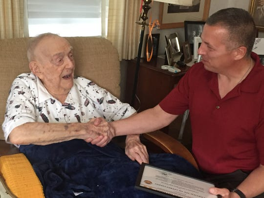 "Army National Guard Major General Steve Ferrari of Winslow  congratulates World War II veteran John ""Jake"" Parvin of Pennsauken  on his 100th birthday  Saturday, June 23. Ferrari commands the 42nd Infantry Division"
