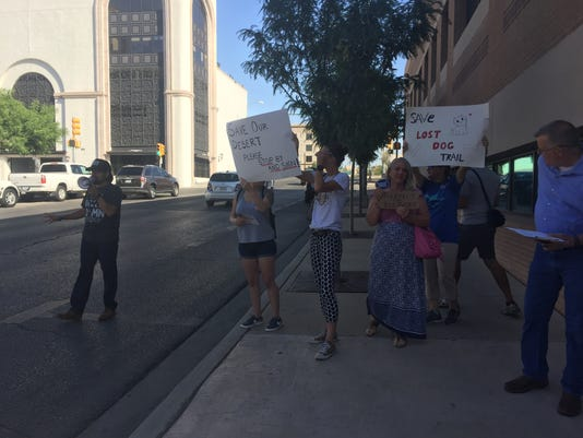 Open space advocates protest in front of City Hall Tuesday