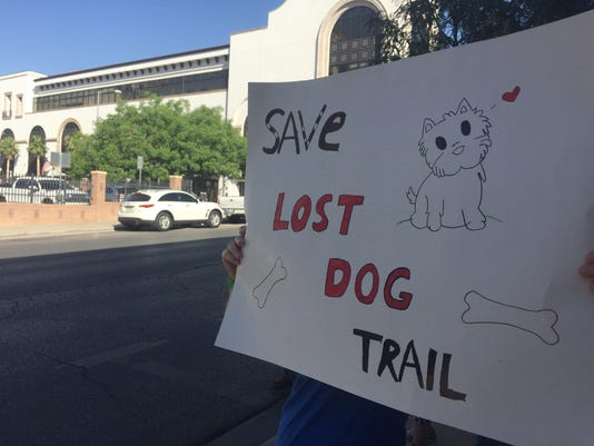 "A sign reads ""Save Lost Dog Trail"""