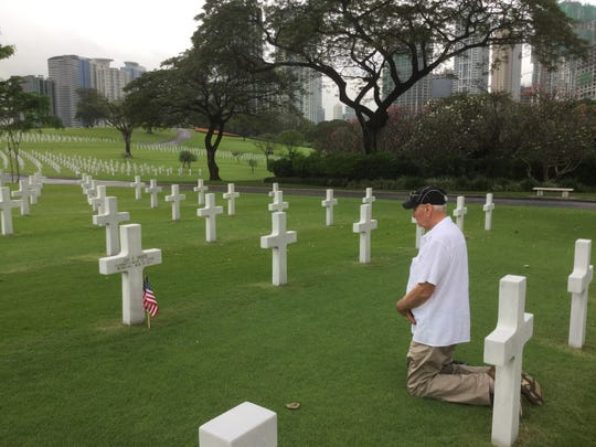 Jack Fried of Colorado was 4 when his father was killed and his visited the gravesite just once, last year. Jay Vee Fried is buried in a large cemetery for U.S. servicemen in Manila, The Philippines.