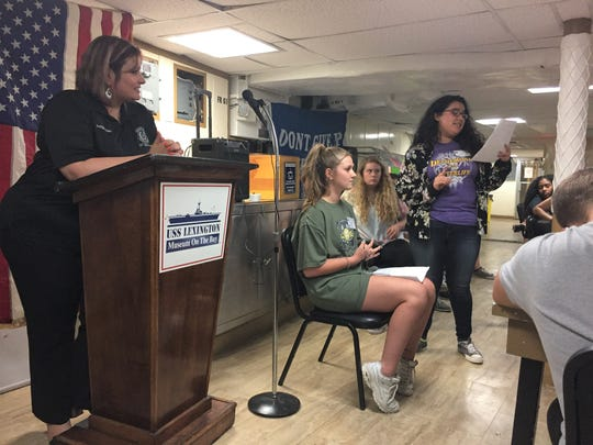 214th District Judge Inna Klein watches over Esmer Lopez, portraying the defense, as she reads out questions to witness Penelope Ackling.