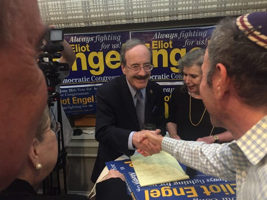 Rep. Eliot Engel is congratulated on his Democratic