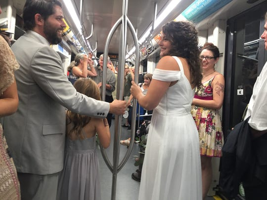 Sarah Thomas, right, and her husband, Chris, rode the Cincinnati Bell Connector streetcar on their wedding day to avoid traffic congestion and parking.